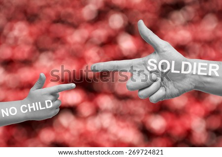 Caucasian male and boy with desaturated hands pointing, or gun gesture, on blurred red background. No Child soldier campaign text. - stock photo