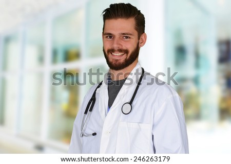Caucasian male doctor working in a hospital - stock photo