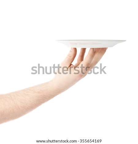 Caucasian male hand holding a white ceramic plate, composition isolated over the white background - stock photo