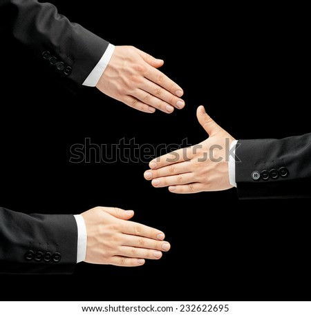 Caucasian male hand in a business suit, opened palm gesture sign offering a handshake in three versions, low-key lighting composition, isolated over the black background - stock photo