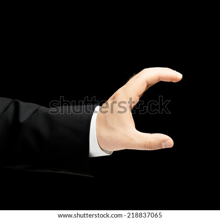 Caucasian male hand in a business suit, showing the size with two fingers gesture sign, low-key lighting composition, isolated over the black background - stock photo