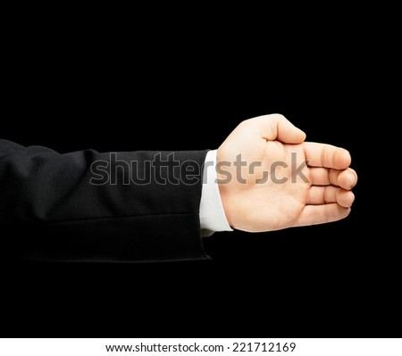 Caucasian male hand in a business suit, slightly bent palm gesture sign, low-key lighting composition, isolated over the black background - stock photo