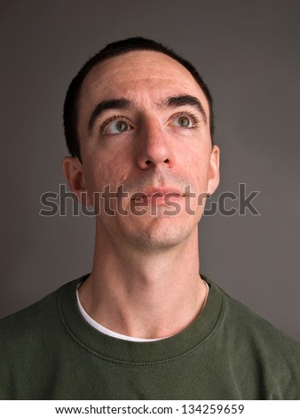 Caucasian Male Headshot Looking Up and Camera Right - stock photo