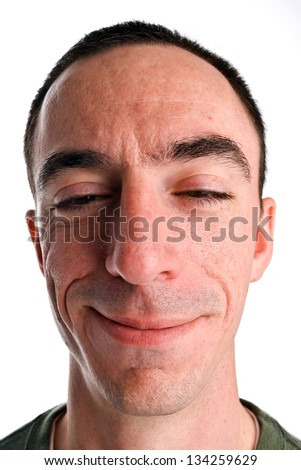 Caucasian Male Headshot with a Strange Look on his Face, Almost as if he has been Drinking - stock photo