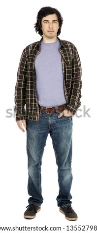 Caucasian male in his early 30's dressed in a casual attire, looking at the camera with a serious expression, hand in pocket of his jeans. - stock photo