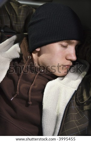 Caucasian male teenager sleeping. - stock photo