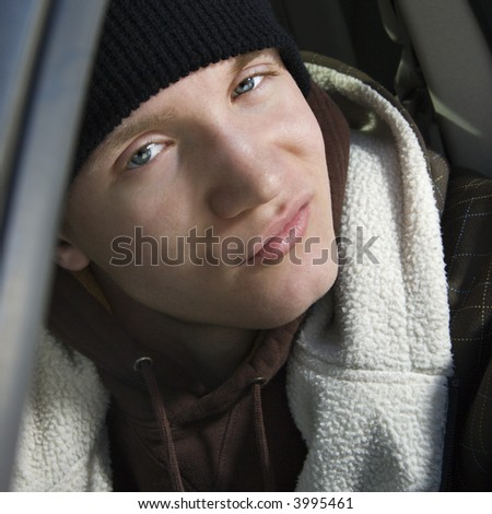 Caucasian male teenager with a smirk - stock photo