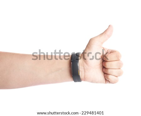 Caucasian male thumbs up gesture hand in a black sport band smart watch, composition isolated over the white background - stock photo