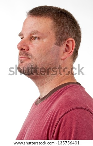 Caucasian male with a goatee in profile view looking left - stock photo