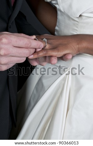 Caucasian man and a black African American woman newly married newlyweds - stock photo