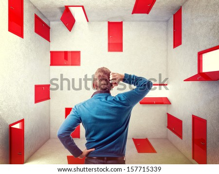 caucasian man and 3d red abstract doors - stock photo