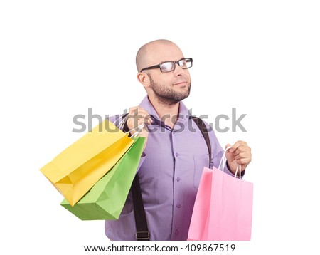 Caucasian man bald, with a beard, glasses with colorful shopping paper bags isolated on white.  - stock photo