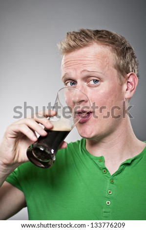 Caucasian Man Drinking Beer - stock photo