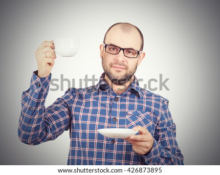 Caucasian man drinking coffee isolated on white background - stock photo