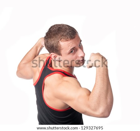 Caucasian man flexing his arm muscule after a working out on a white background - stock photo