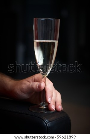 caucasian man hold a glass of prosecco - stock photo