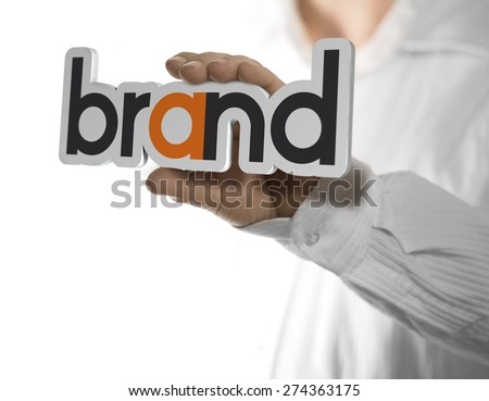 Caucasian man holding a brand name, copy space on the left side of the image. Identity concept over white background. - stock photo