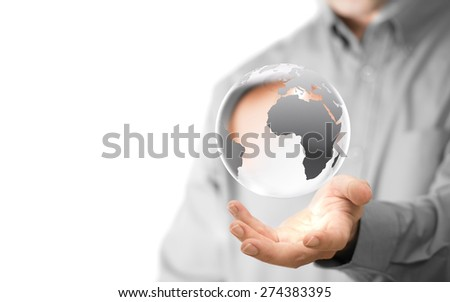 Caucasian man holding a glass planet, copy space on the left side of the image. Global business background concept over white. - stock photo