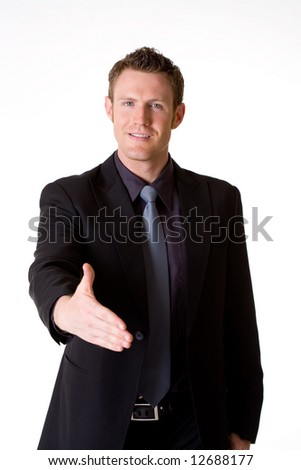 caucasian man in business suit hand shaking making a deal - stock photo
