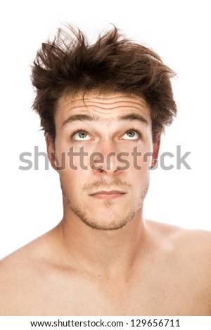 Caucasian man looking up (isolated on white) - stock photo
