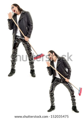 Caucasian man playing broom like guitar against white background. - stock photo