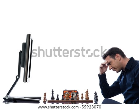 caucasian man playing chess concentrated against computer concept on isolated white background - stock photo