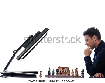 caucasian man playing chess with computer reflective  concept on isolated white background - stock photo