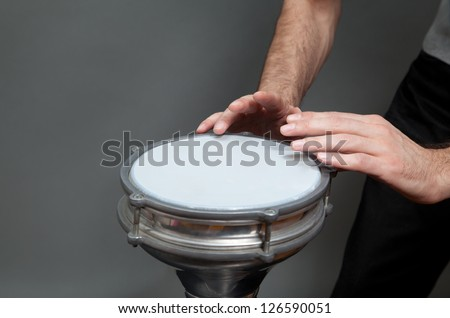 caucasian man playing percussion