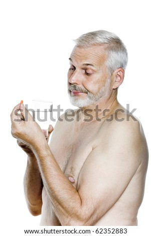 caucasian man portrait taking pill displeased isolated studio on white background