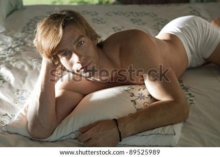 Caucasian man relaxing in bed.