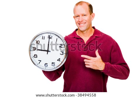 Caucasian man showing a clock and smiling isolated over white - stock photo