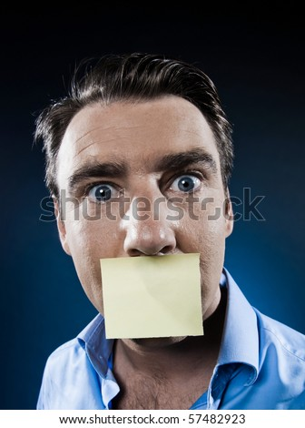 caucasian man surprised mouth shut by note paper portrait isolated studio on black background - stock photo