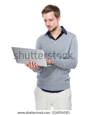 Caucasian man use of laptop computer - stock photo