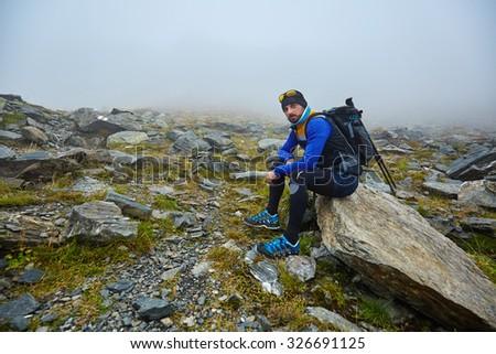 Caucasian man with backpack hiking into the mountains