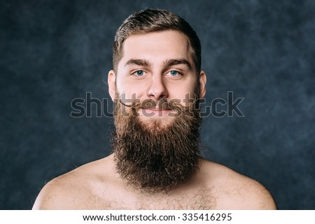 Caucasian man with funny spinning mustache and big beard. Horizontal - stock photo