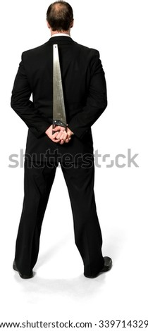 Caucasian man with short medium blond hair in business formal outfit holding saw - Isolated