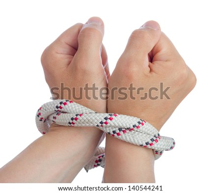 Caucasian man wrists bounded together with rope.