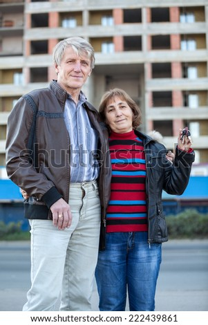 Caucasian mature loving coupe portrait with house keys in hand - stock photo