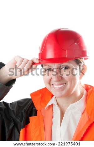 Caucasian mature woman in a red helmet and workwear, isolated on a white background. - stock photo