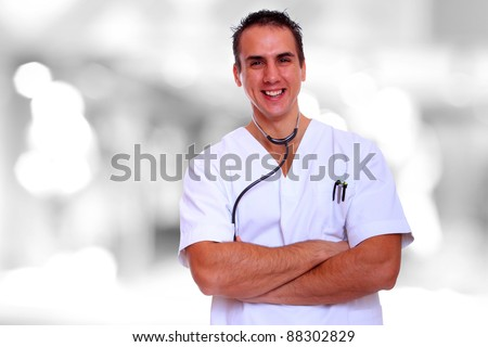 Caucasian mid adult male doctor over bokeh blue background - stock photo