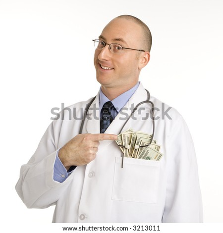 Caucasian mid adult male physician with cash hanging out of pocket. - stock photo