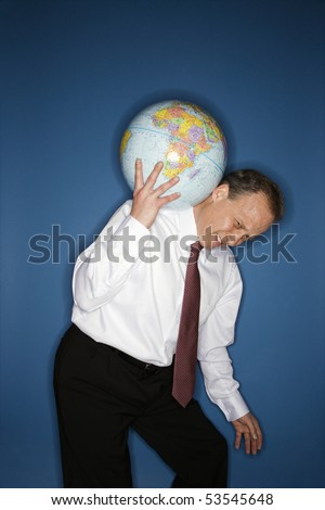 Caucasian middle aged businessman carrying weight of the world on his shoulders. - stock photo