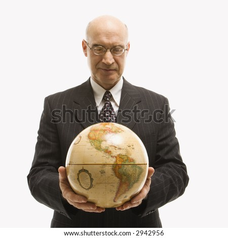 Caucasian middle-aged businessman holding globe in both hands standing in front of white background. - stock photo