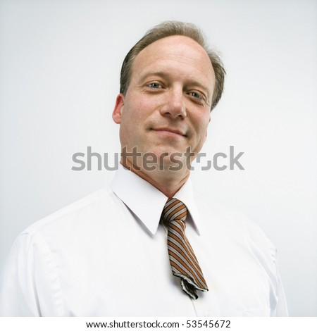 Caucasian middle aged businessman portrait with cut necktie. - stock photo