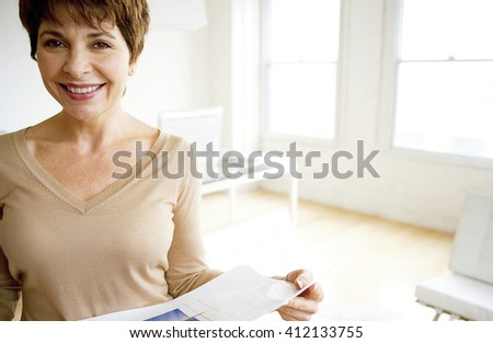 caucasian middle aged woman in empty room - stock photo