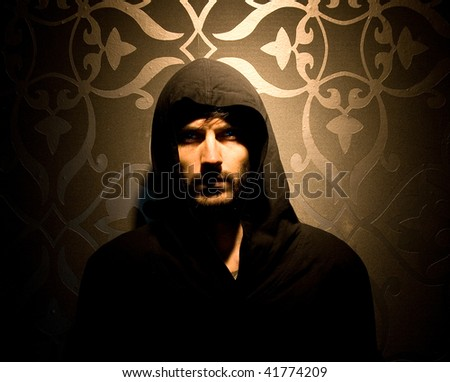 Caucasian model with hood over his head - stock photo