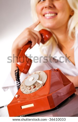 caucasian model with red phone - stock photo