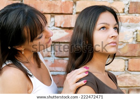 caucasian mother and daughter portrait sideview, supporting - stock photo