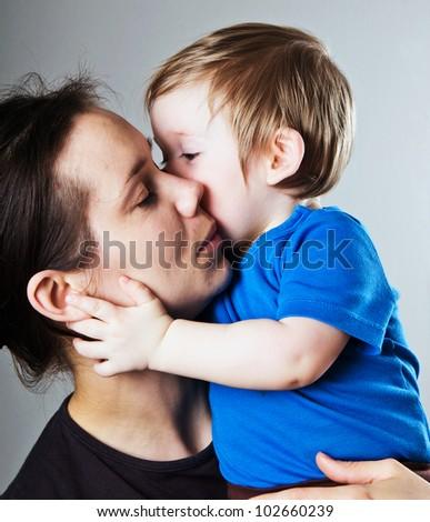 caucasian mother hugging her child - stock photo