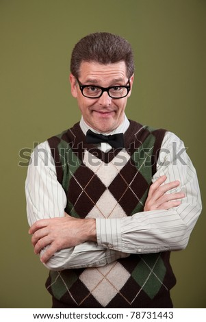 Caucasian nerd with arms folded on green background - stock photo